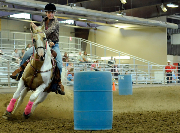 Andrea Skinner, 16, of Berthoud, rounds a barrel during the barrel races at the Indoor Arena at the Boulder County Fairground in Longmont on Thursday, July 29.<br /> Jeremy Papasso/ Camera