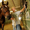 """Tyler Faye, 12, of Firestone, puts """"Moose"""" the horse back in his stall at the Indoor Arena at the Boulder County Fairground in Longmont on Thursday, July 29. Faye was returning the horse after cleaning him for halter and showmanship.<br /> Jeremy Papasso/ Camera"""