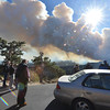 12EPNews Fire from 3M Curve.jpg Visitors stop at 3M curve to watch the column of smoke rise and drift toward Estes Park on Tuesday. The fire closed several roads, forcing visitors to different vantage points to try to view the fire.