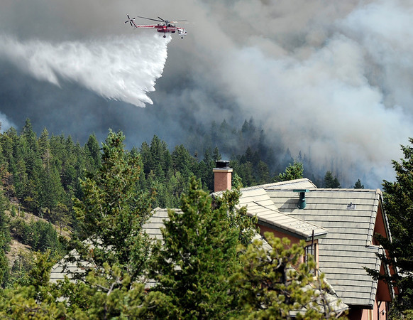 """A helicopter drops water on the fire while fighting the Flagstaff wildfire on Tuesday, June 26, in Boulder. For a video of the fire go to  <a href=""""http://www.dailycamera.com"""">http://www.dailycamera.com</a><br /> Jeremy Papasso/ Camera"""