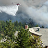 "A helicopter drops water on the fire while fighting the Flagstaff wildfire on Tuesday, June 26, in Boulder. For a video of the fire go to  <a href=""http://www.dailycamera.com"">http://www.dailycamera.com</a><br /> Jeremy Papasso/ Camera"