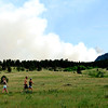 Hikers walk across the path near Baseline Rd. in front of the flagstaff fire Tuesday afternoon. Rachel Woolf/ Daily Camera