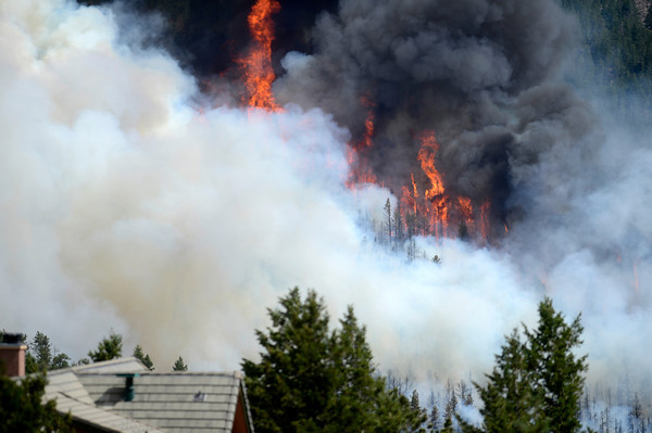 "Flames and plumes of smoke are seen behind a home on Tuesday, June 26, during the Flagstaff fire in Boulder. For a video of the fire go to  <a href=""http://www.dailycamera.com"">http://www.dailycamera.com</a><br /> Jeremy Papasso/ Camera"