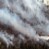 20120626_BOULDER_WILDFIRE_226.jpg A helicopter dumps water on a wildfire burning near Flagstaff Road and Bison Drive, Tuesday, June 26, 2012 near Boulder.<br /> (Matthew Jonas/Times-Call)