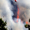 A firefighting helicopter flies above the fire near Bison Drive on Tuesday west of Boulder.<br /> Photo by Jeremy Papasso.<br /> South Boulder Peak FIre001.JPG