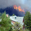 "Fire rages behind a house on Tuesday, June 26, during the Flagstaff fire in Boulder. For a video of the fire go to  <a href=""http://www.dailycamera.com"">http://www.dailycamera.com</a><br /> Jeremy Papasso/ Camera"