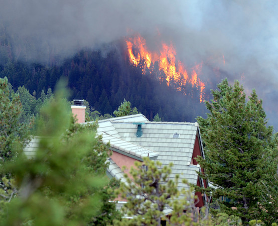 """Fire rages behind a house on Tuesday, June 26, during the Flagstaff fire in Boulder. For a video of the fire go to  <a href=""""http://www.dailycamera.com"""">http://www.dailycamera.com</a><br /> Jeremy Papasso/ Camera"""