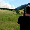 Luke Rague, of Boulder  photographs the flagstaff fire at the bottom of Baseline Rd. Tuesday afternoon. Rachel Woolf/ Daily Camera