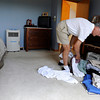 "Bill Holmes sorts through clothing while packing up after getting an evacuation call during the Flagstaff wildfire on Tuesday, June 26, in Boulder. For a video of the fire go to  <a href=""http://www.dailycamera.com"">http://www.dailycamera.com</a><br /> Jeremy Papasso/ Camera"