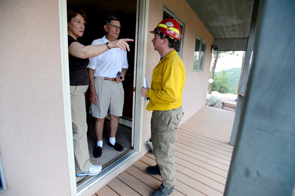 "Homeowners Bill and Glenda Holmes talk with Rocky Mountain Rescue's Aaron Peavey while being evacuated during the Flagstaff wildfire on Tuesday, June 26, in Boulder. For a video of the fire go to  <a href=""http://www.dailycamera.com"">http://www.dailycamera.com</a><br /> Jeremy Papasso/ Camera"