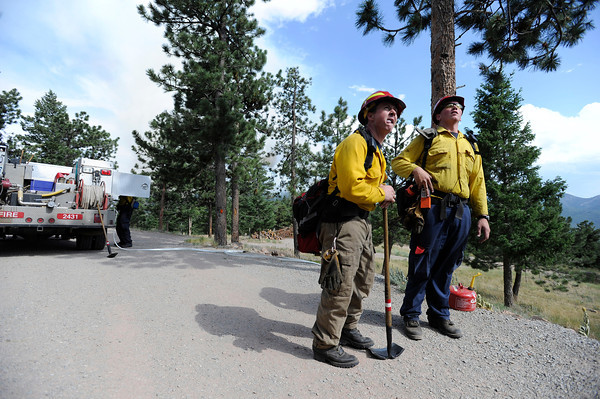 "Rocky Mountain Rescue workers Aaron Peavey, left, and Kyle Lyman make a game plan while fighting the Flagstaff wildfire on Tuesday, June 26, in Boulder. For a video of the fire go to  <a href=""http://www.dailycamera.com"">http://www.dailycamera.com</a><br /> Jeremy Papasso/ Camera"