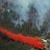 20120626_BOULDER_WILDFIRE_133.jpg A slurry bomber tries to create a barrier to keep the fire from spreading near, Tuesday, June 26, 2012 near Boulder.<br /> (Matthew Jonas/Times-Call)
