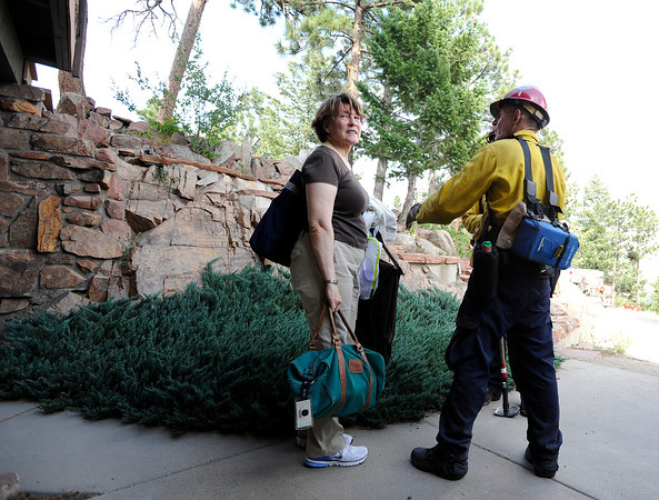 """Homeowner Glenda Holmes talks with Rocky Mountain Rescue workers while evacuating their home during the Flagstaff wildfire on Tuesday, June 26, in Boulder. For a video of the fire go to  <a href=""""http://www.dailycamera.com"""">http://www.dailycamera.com</a><br /> Jeremy Papasso/ Camera"""