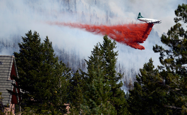 "A heavy tanker drops fire retardant while fighting the Flagstaff wildfire on Tuesday, June 26, in Boulder. For a video of the fire go to  <a href=""http://www.dailycamera.com"">http://www.dailycamera.com</a><br /> Jeremy Papasso/ Camera"