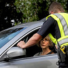 An unidentified resident talks to the police on Baseline Rd. where she is unable to drive any further due to the flagstaff fire Tuesday afternoon. Rachel Woolf/ Daily Camera