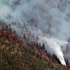 20120626_BOULDER_WILDFIRE_179.jpg A helicopter dumps water on a wildfire burning near Flagstaff Road and Bison Drive, Tuesday, June 26, 2012 near Boulder.<br /> (Matthew Jonas/Times-Call)