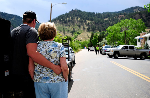 Wesley Kugel puts his arm around, Fran MacAnally, who lived near the burning area of the flagstaff area at the bottom of Baseline Rd. Tuesday afternoon. Rachel Woolf/ Daily Camera