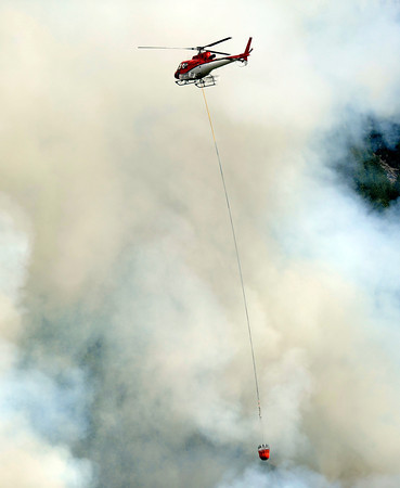 "A helicopter drops water on the flames while fighting the Flagstaff wildfire on Tuesday, June 26, in Boulder. For a video of the fire go to  <a href=""http://www.dailycamera.com"">http://www.dailycamera.com</a><br /> Jeremy Papasso/ Camera"