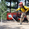 "Rocky Mountain Fire worker Aaron Peavey unwinds a fire hose while fighting the Flagstaff wildfire on Tuesday, June 26, in Boulder. For a video of the fire go to  <a href=""http://www.dailycamera.com"">http://www.dailycamera.com</a><br /> Jeremy Papasso/ Camera"