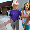 Fourth grade teacher Paul Nigro, wearing a chicken hat listens to one of his former students Faith West, now a fifth grader, talk about her summer on the first day of school at Ryan Elementary School in Lafayette on Monday Morning<br /> Photo by Paul Aiken / The Camera / 8/ 15/ 11