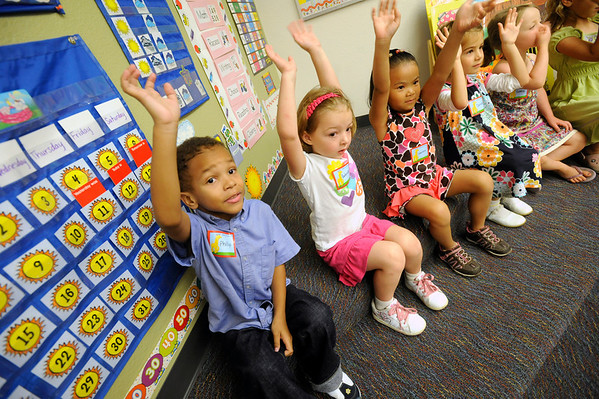 From left to right Phillip Holmes, Gabrielle Kelley , Lauren Kidney and Daniela Borlovan wave goodbye to her parents on their first day of kindergarten on the first day of school at Ryan Elementary School in Lafayette on Monday Morning. <br /> Photo by Paul Aiken / The Camera / 8/ 15/ 11