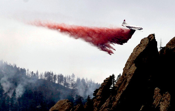 Day 2 Fire_001.jpg A heavy tanker makes a fire suppressant drop on the northeast side of the Flagstaff Fire in Boulder, Colorado June 27, 2012. DAILY CAMERA/ Rachel Woolf