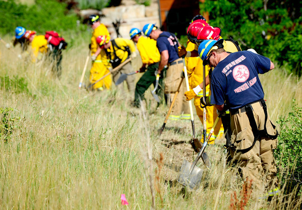 0627FIRE1.jpg Fire fighters work at creating a fire line break near between Stony Hill and Cragmore as a precaution in case the Flagstaff fire moved toward the neighborhood in South Boulder in Boulder, Colorado June 27, 2012.  DAILY CAMERA/ Rachel Woolf