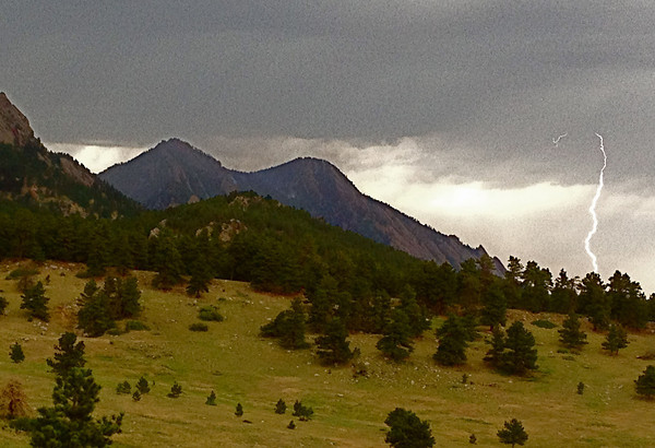 A lightning strike is seen over the Foothills near Boulder on Wednesday afternoon as seen from Coal Creek Canyon.<br /> Photo courtesy Carly Rixham