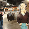 FLATIRONS2.jpg Flatirons Community Church Creative Director Chris Coleman videotapes the church's new lobby area including a cutout of Lead Pastor Jim Burgen in Lafayette on Thursday March 17, 2011. <br /> Photo by Paul Aiken