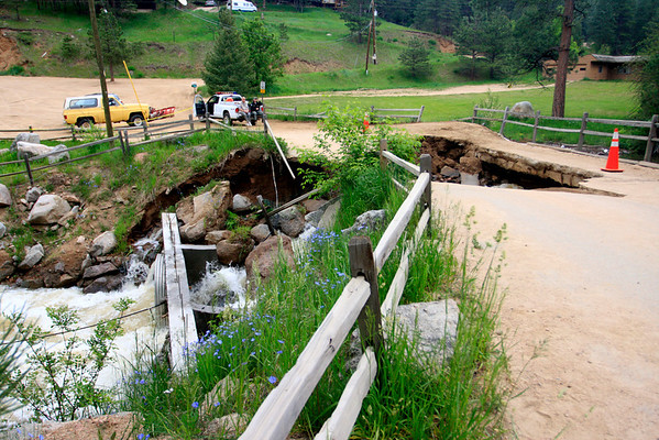 The scene outside the Red Lion Inn with the damaged bridge that separates his restaurant from Boulder Canyon Drive.<br /> Photo by Greg Lindstrom / Daily Camera /