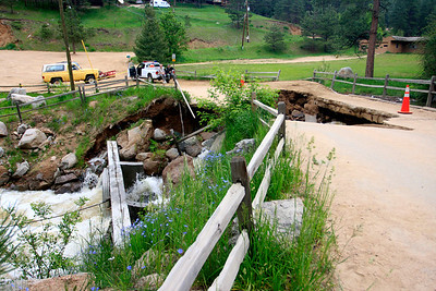 The scene outside the Red Lion Inn with the damaged bridge that separates his restaurant from Boulder Canyon Drive. Photo by Greg Lindstrom / Daily Camera /