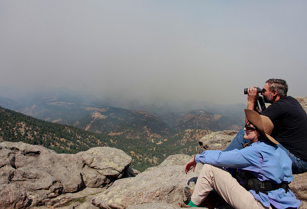 20100906Fourmile-1.jpg A couple who declined to be identified watches the Fourmile Canyon fire from the Lost Gulch on Flagstaff road on Monday. (Photo/Stephanie Davis)
