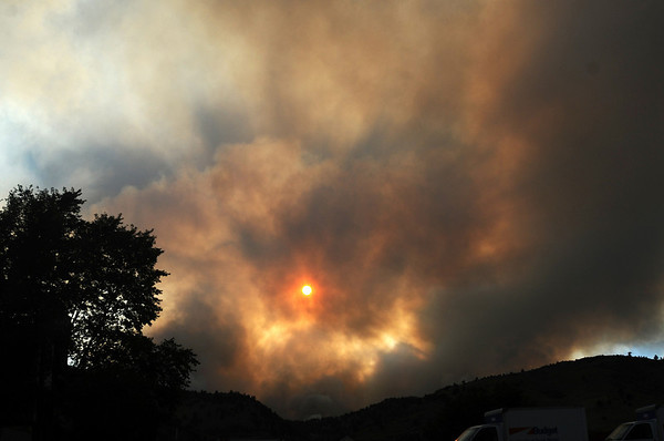 FOURMILE<br /> Late-day sun shines through the smoke from the Fourmile Canyon fire.<br /> Photo by Marty Caivano/Camera/Sept.6, 2010