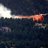 A slurry bomber drops a load of fire suppressant near threateded home in the Fourmile Canyon fire in Boulder, Colorado September 6, 2010.  CAMERA/Mark Leffingwell