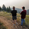 FOURMILE<br /> Shawn Bebout, left, and his son Caleb, of Longmont, watch the Fourmile Canyon fire from Gold Hill Road on Monday. <br /> Photo by Marty Caivano/Camera/Sept.6, 2010