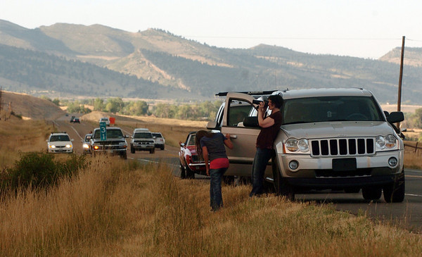 "Several people stopped along Foothill Highway, north of Boulder, to photograph the fire and the smoke over the county.<br /> For  videos and photos of the fire,  go to  <a href=""http://www.dailycamera.com"">http://www.dailycamera.com</a>.<br /> Cliff Grassmick / September 6, 2010"