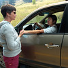 Lisa Van Leuwen-Hall, at left, greets a neighbor Elaine Smith who was driving down Sunshine Canyon after being evacuated from the fire Monday afternoon. Leuwen-Hall was working in Boulder when the fire started and can't bet back to her home near Gold HIll.<br /> Photo by Paul Aiken / The Camera