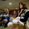 Julian Eagleheart, left and Judy Frey watch coverage of the Fourmile Fire at the Coors Events Center on the CU Boulder Campus Monday Evening. The facility is being used by the Red Cross as an overnight shelter. Both are residents of the mountains west of Boulder and evacuated due to the fire.  Neither is aware of the status of the places they evacuated. Paul Aiken / The Camera