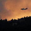 "A slurry bomber makes a run into the fire near sunset.<br /> For  videos and photos of the fire,  go to  <a href=""http://www.dailycamera.com"">http://www.dailycamera.com</a>.<br /> Cliff Grassmick / September 6, 2010"
