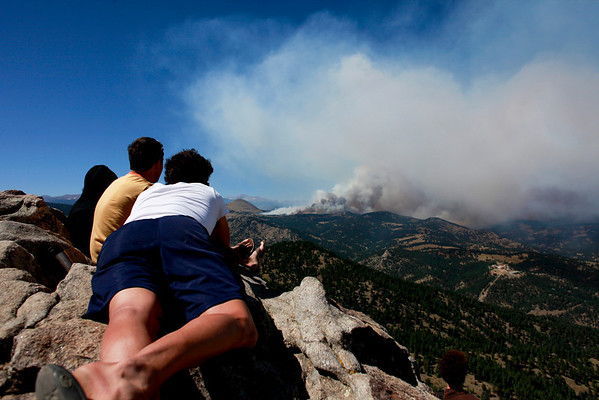 20100906Fourmile-5.jpg From left to right, Jamie DeBergh, Josh Winer and Marcus DeBergh watch the fire in Fourmile Canyon from the Lost Gulch on Flagstaff Road on Monday. (Photo/Stephanie Davis)