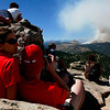 20100906Fourmile-4.jpg Hilary Marsh, of Boulder, and Ioan Feier, of Ohio, watch the Fourmile Canyon fire from the Lost Gulch on Flagstaff Road on Monday. (Photo/Stephanie Davis)