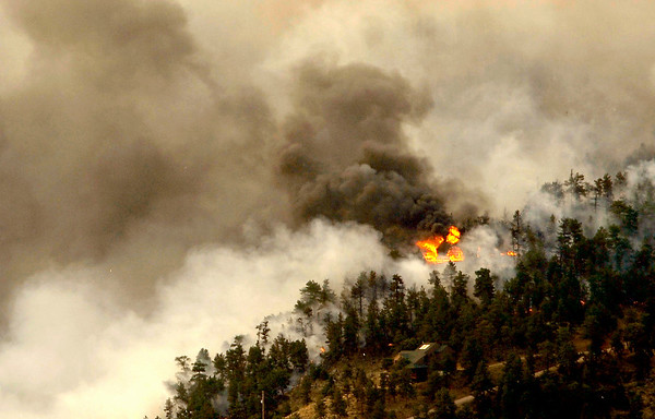 A home burns in the Fourmile Canyon fire in Boulder, Colorado September 6, 2010.  CAMERA/Mark Leffingwell