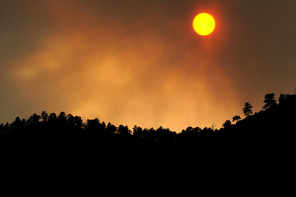 """Smoke from the Fourmile Canyon Fire covers the sun for an orange sunset from Foothills Highway.<br /> For  videos and photos of the fire,  go to  <a href=""""http://www.dailycamera.com"""">http://www.dailycamera.com</a>.<br /> Cliff Grassmick / September 6, 2010"""