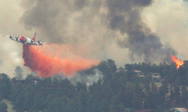 Slurry bombers drop fire retardant along the foothills of Boulder Monday afternoon. <br /> <br /> <br /> Photo by Patrick Kelley / For The Camera