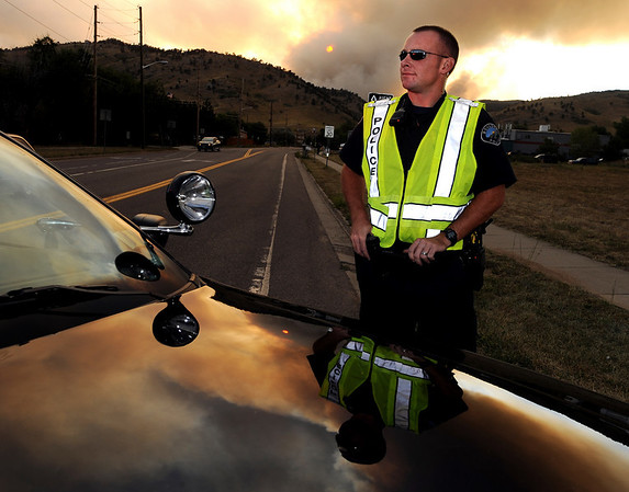 """Boulder Police officer, E.K. Burke, works a road block at Lee Hill Road and Broadway.<br /> For  videos and photos of the fire,  go to  <a href=""""http://www.dailycamera.com"""">http://www.dailycamera.com</a>.<br /> Cliff Grassmick / September 6, 2010"""