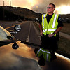 "Boulder Police officer, E.K. Burke, works a road block at Lee Hill Road and Broadway.<br /> For  videos and photos of the fire,  go to  <a href=""http://www.dailycamera.com"">http://www.dailycamera.com</a>.<br /> Cliff Grassmick / September 6, 2010"