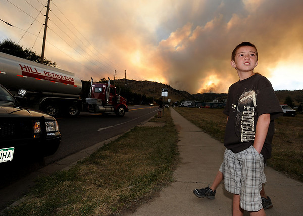 "Austin Pettit and his brother, Brandon, not pictured, watch the activity around Lee Hill Road and Broadway.<br /> For  videos and photos of the fire,  go to  <a href=""http://www.dailycamera.com"">http://www.dailycamera.com</a>.<br /> Cliff Grassmick / September 6, 2010"