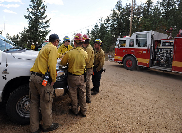 "Firefighters on Deer Trail Road in Boulder Heights plan their work for  the day on September 10, 2010.<br /> For  videos  and photos relating to the fire,  go to  <a href=""http://www.dailycamera.com"">http://www.dailycamera.com</a>.<br /> Cliff Grassmick / September 10, 2010"