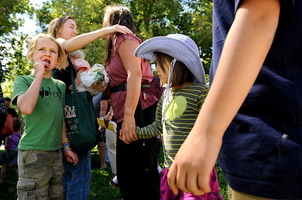 Gold Hill Elementary students Carter Schuller, left, and Wren Hybertson, middle, look at their new school while Carter's mother Tisha Schuller, back left, hugs another students mother, on Friday, Sept. 10, at Foothill Elementary School in Boulder. The students that attend Gold Hill Elementary School will be attending Foothill Elementary until their school is reopened. Gold Hill Elementary School was shut down due to the wildfire. The second woman in the photo refused to give her name.<br /> Jeremy Papasso/ Camera