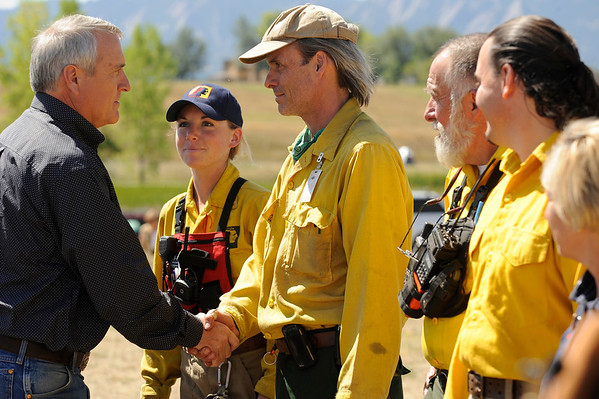 Colorado Gov. Bill Ritter thanks volunteer firefighters Molly Wineteer of the Left Hand Fire Protection District, Mark Wischmeyer, of the Jamestown Fire Department and Rob Bozeman of the Boulder Mountain Fire Protection District  at the staging area at Boulder Reservoir, Friday, Sept. 10, 2010 in Boulder, Colo.  (AP Photo/The Denver Post, Craig F.Walker)  MANDATORY CREDIT; MAGS OUT; TV OUT